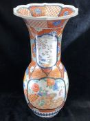 Large Chinese vase with panels depicting large orange chrysanthemums, Blossom and flowers and birds.