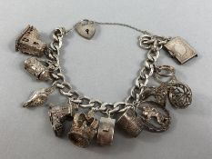 Silver hallmarked bracelet and a selection of silver charms (mostly marked silver) total weight