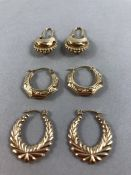 Three pairs of 9ct Gold earrings of various designs (approx 4g)