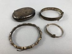 Hallmarked silver items to include three silver bangles and a silver snuff box (A/F)