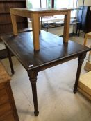 One low pine table and one dark stained table