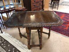 Heavily carved oak drop leaf table with barley twist legs