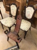 Pair of upholstered chairs with carved detailing and a carved stool