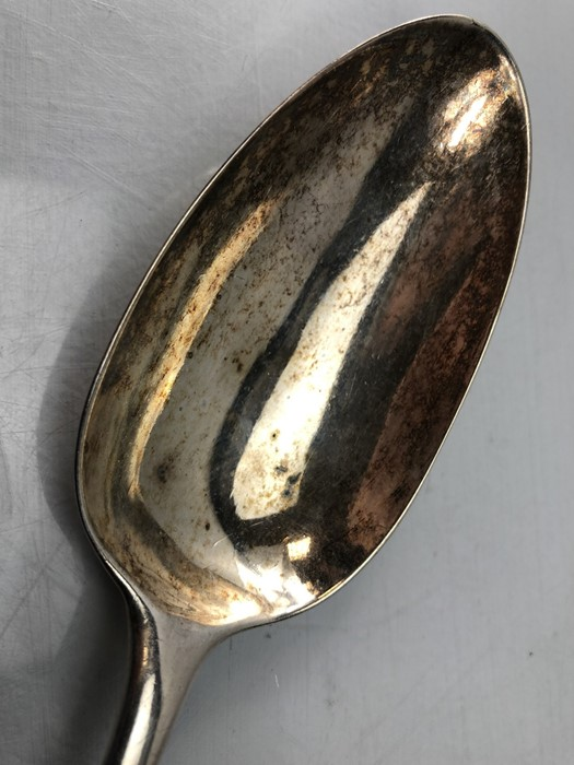 """Lot 40 - Large Silver serving spoon London 1767 maker JE (Listed by Grimwade as an """"Unregistered Mark"""" and"""