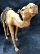 Leather figure of a camel (believed to be originally from Liberty's) approx 62cm high (A/F)