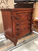 Apprentice piece chest of drawers, each drawer with turned wood handles, flanked by turned