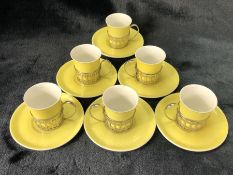Set of six Shelley espresso cups and saucers in yellow with hallmarked silver holders