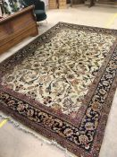 Large cream ground antique rug with blue and pink floral design, approx dimensions 385cm x 260cm