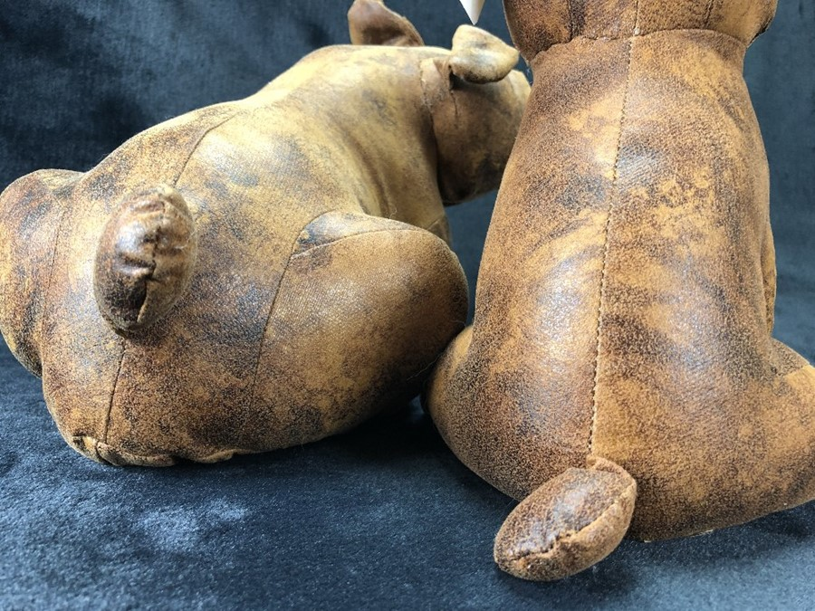 Lot 227 - Two decorative leather dogs, approx 27cm and 23cm tall