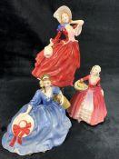 Three Royal Doulton figurines: 'Autumn Breezes', 'Elyse' and 'Janet'