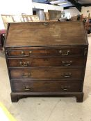 Four drawer bureau with brass handles and drop leaf to reveal inner compartments. With key