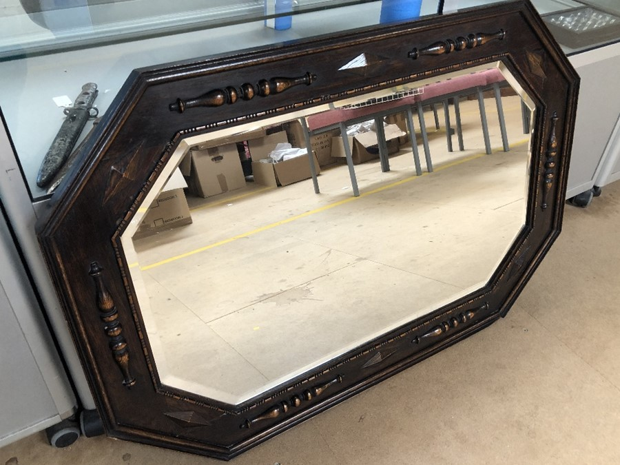 Lot 229 - Large octagonal carved wooden framed bevel edged mirror, approx 106cm x 70cm