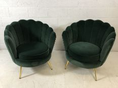 Pair of modern Art-Deco style green velvet scalloped back chairs with brass coloured legs, approx
