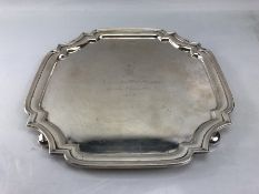Silver salver or tray approx 30.5cm square engraved with Golfing emblem and wording on bun feet (