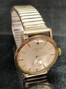 Gents LONGINES gold watch with gold batons, case marked 9ct 375, in working condition, inscribed