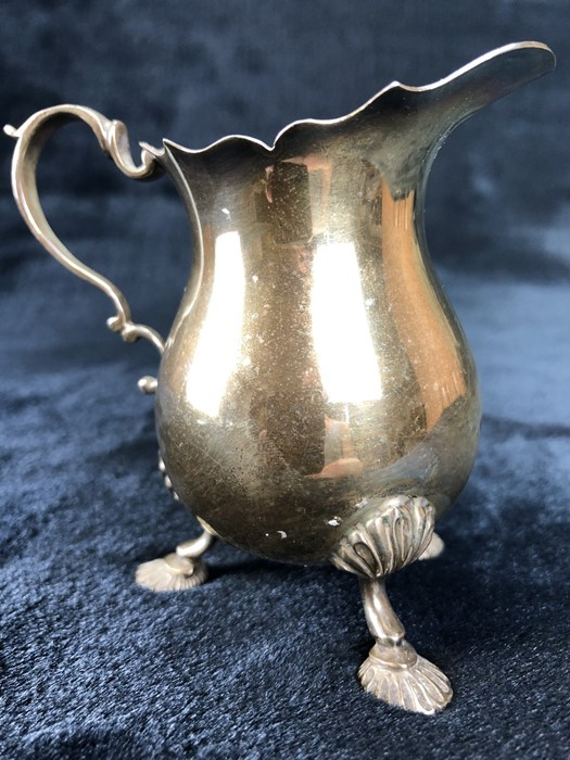 Silver Hallmarked milk jug on three splayed feet London by maker Payne & Son (approx 112g