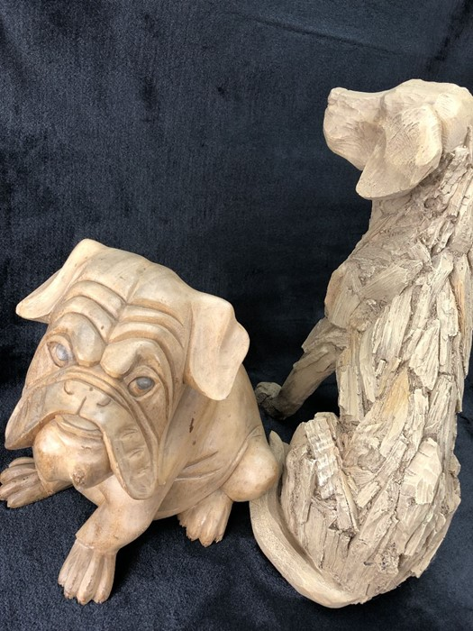 Lot 215 - Two carved decorative dogs, the larger approx 40cm tall, the smaller approx 27cm