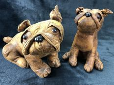 Two decorative leather dogs, approx 27cm and 23cm tall