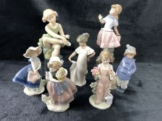 Collection of three Lladro and three Nao figurines, along with a figurine of a ballerina by D'