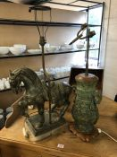 Two decorative lamp bases, one in the form of a twin handled urn, the other in the form of a horse