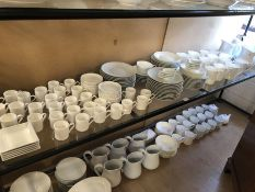 Large collection of white dinnerware and tableware over two shelves