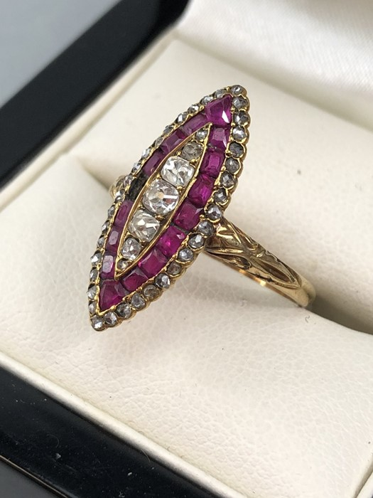 Lot 55 - 18ct Gold marquis ring set with an outer layer of rose cut diamonds, five old mine cut Diamonds to