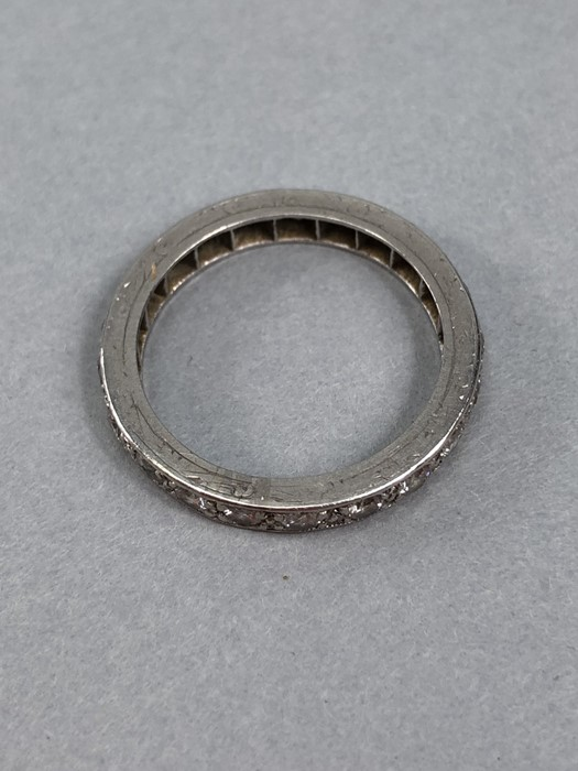 Lot 56 - White Gold full eternity ring set with Diamonds size 'O' (approx 5g)
