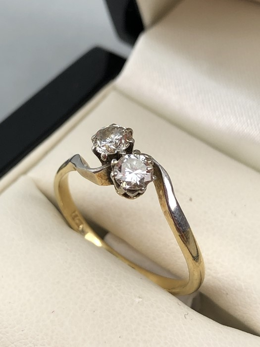 Lot 57 - 18ct Gold and platinum set two stone diamond crossover ring, diamonds approx 0.25ct each, size 'Q'