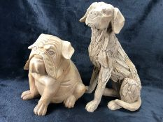 Two carved decorative dogs, the larger approx 40cm tall, the smaller approx 27cm