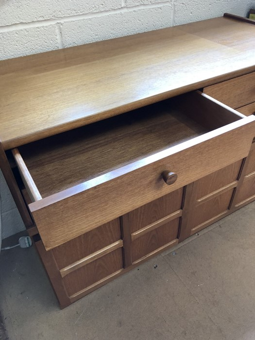 Lot 150 - Mid century teak sideboard with four drawers and cupboard under with panelled doors approx 102cm x
