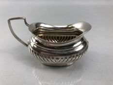 Small hallmarked silver cream/sauce jug marked Chester 1899 Maker William Aitken (approx 4cm tall at
