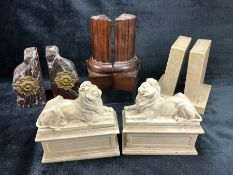 Four pairs of book ends, three marble, to include a pair of lions on plinths