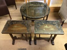 Circular tilt-top, glass topped occasional table with engraved oriental scene, approx diameter 61cm,