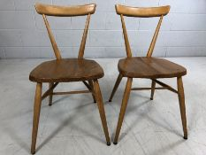 Pair of vintage Ercol blond stacking chairs on tapered legs, approx height 74cm