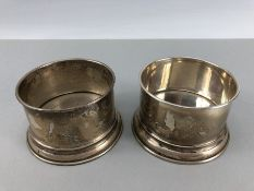"""Pair of silver (marked 900 to base maker """"AL"""") wine holders"""