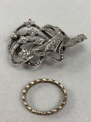 Marcasite floral spray brooch marked silver to reverse & one unmarked Gold eternity style ring (