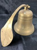 Vintage brass bell with wall bracket