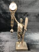 A bronze swinging pendulum mystery clock, in the from of a Pilot holding a propeller. Approx. 37cm