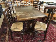 Refectory-style extending dining table with four ladder back, rush seated chairs. Table approx 206cm