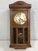 1930s German striking wall clock with pendulum and key