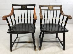 Pair of `Harvard` ebonised elbow chairs with gilt Harvard Veritas seal to splats by Nichols and