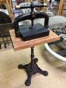 Antique cast iron book press, comes with improvised wrought iron stand