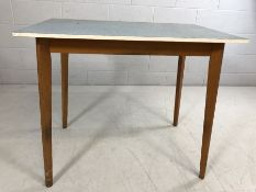 Retro formica-topped kitchen table with tapered legs, approx 91cm x 60cm x 76cm tall