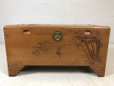 Camphor style chest with carved bamboo design approx 88cm x 44cm x 45cm tall