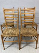 Four light wood ladder back chairs with rush seats