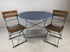 Pair of folding garden chairs with black metal frames and wooden slatted seats, stamped to back '