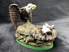 Cast metal money box in the form of a bird feeding two chicks (A/F)