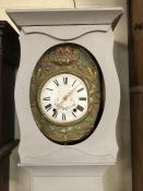 Decorative longcase clock with grey paint finish, white face with black roman numerals and flower