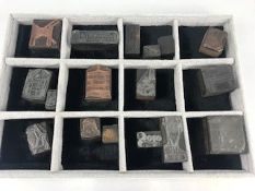 Collection of seventeen vintage copper printing blocks to include images of guns, bird cages,