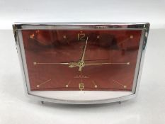 Retro alarm clock orange/ red face and gold batons and hands, clockface approx 14 x 9cm